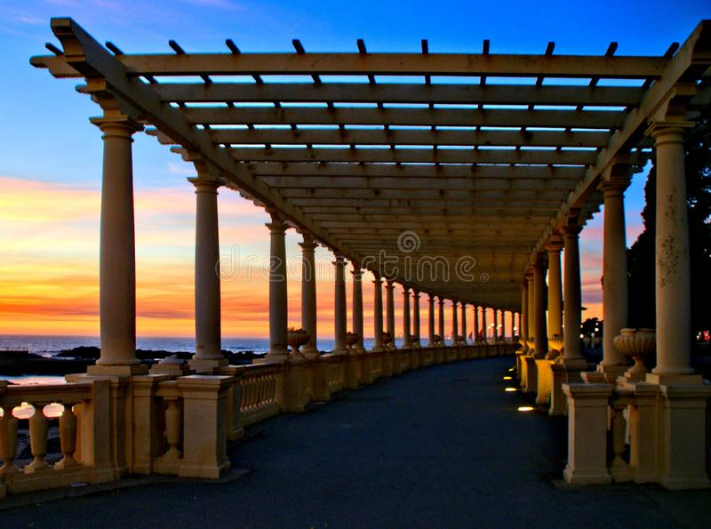 Coastal way sunset with Pergola at Foz do Douro. Oporto, Portugal royalty free stock photo
