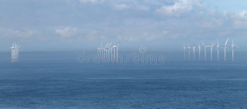 Coastal Wind Farm. Three Rows of Turbines on a Coastal Wind Farm royalty free stock image