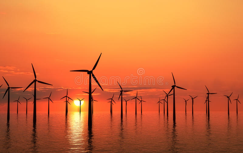 Coastal wind turbines sunset stock photography