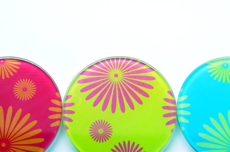 Coasters coloridos foto de stock