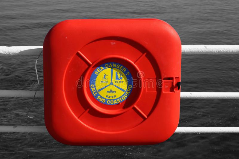 Coastguard safety rescue ring in a box on railings stock images