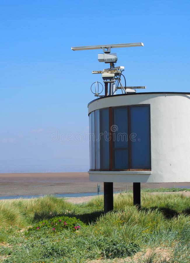 Free Coastguard Station In Fleetwood With Radar Antennae With Crass Covered Dunes Leading To The Beach On A Summers Day In Brig Stock Images - 119189114