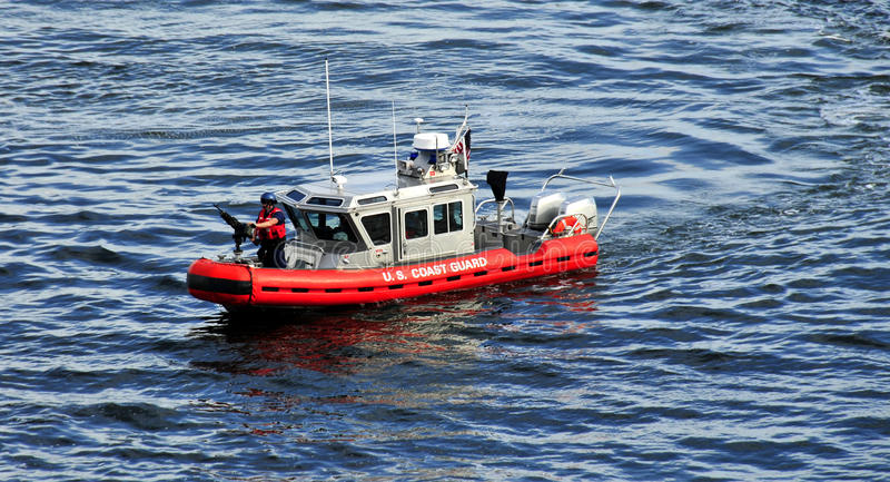 Coastguard vesel or ship. Coastguard vessel or ship in blue sea royalty free stock images