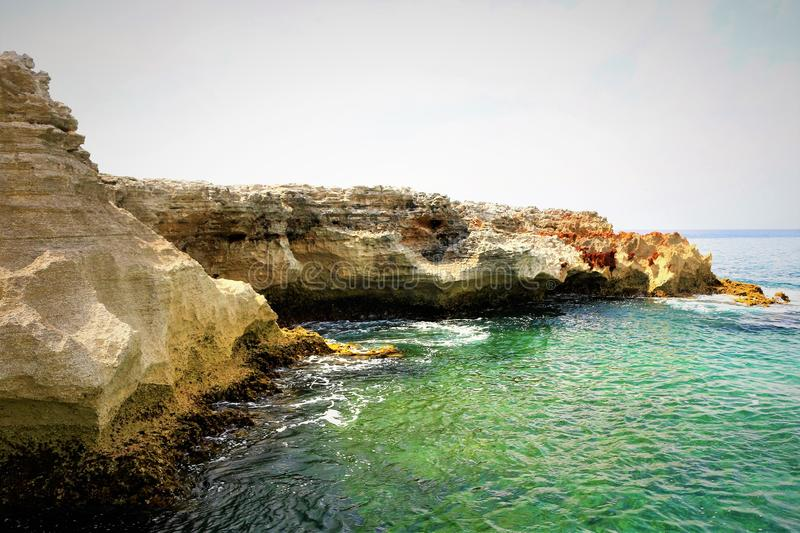 Coastline of the Atlantic Ocean by the Queens Bath on Eleuthera in the Bahamas. Blue green clear water stock photo