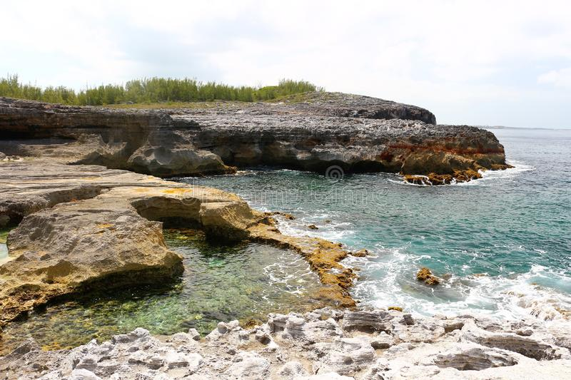 Coastline of the Atlantic Ocean at the Queens Bath on Eleuthera in the Bahamas. Blue green clear water with surf washing up on the rocks stock photo