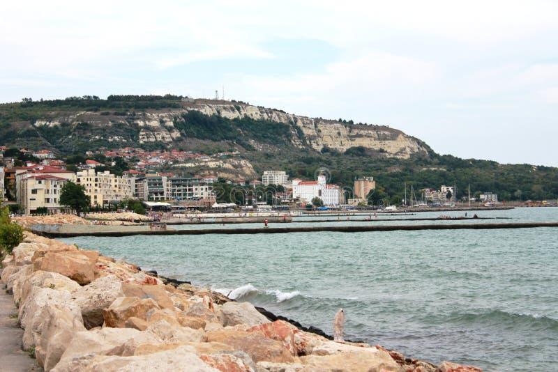 The coastline in Balchik, Bulgaria. Photo made in Balchik, Bulgaria at the Black Sea. Whire rocks, little port, many hotels and long pronenade royalty free stock photos