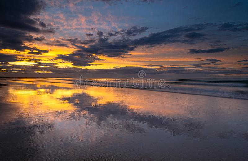 Coastline beach sunset on the shore at Bamburgh, Northumberland in north east England. royalty free stock photos