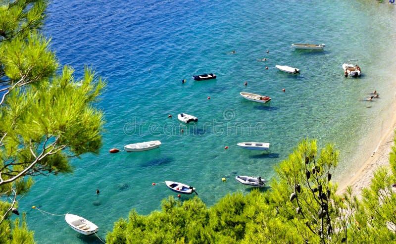Coastline with boats on perfect clear sea. Croatian coastline with some boats on super-clear water near the beach stock photo