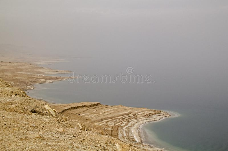 Coastline of Dead Sea - salt on coast and in water,View from above.Salt crystals natural mineral formation may be different forms. Dead Sea has a salinity royalty free stock image