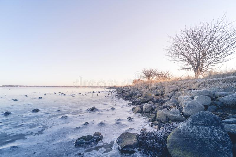 Coastline by a frozen sea in the winter royalty free stock photos