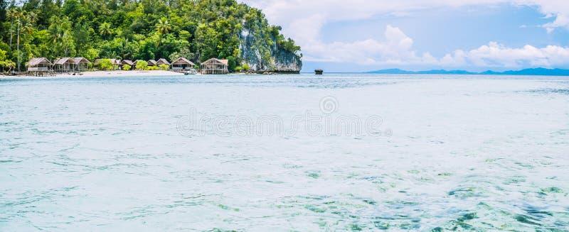 Coastline with Homestay onKri Island. Raja Ampat, Indonesia, West Papua. Coastline with Homestay on Kri Island, Raja Ampat, Indonesia, West Papua stock images