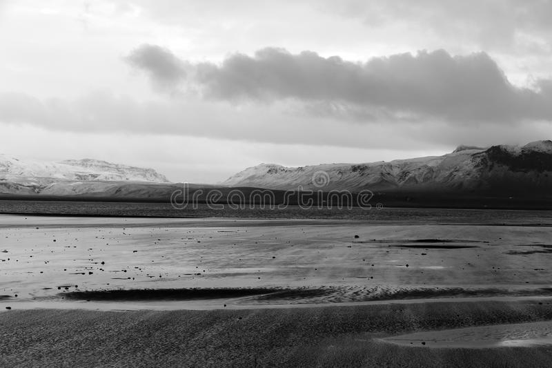 Coastline in Iceland durign a rainy day in fall. In black and white stock images