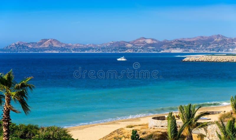 Coastline of Los Cabos. Yacht and coastline of Los Cabos, Mexico royalty free stock photography