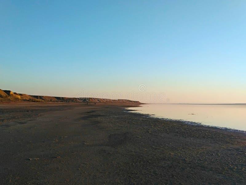 The coastline. Is lost beyond the horizon line. Shooting time is evening, before sunset. Autumn 2018, Kuyalnik, Odessa region, Ukraine stock image