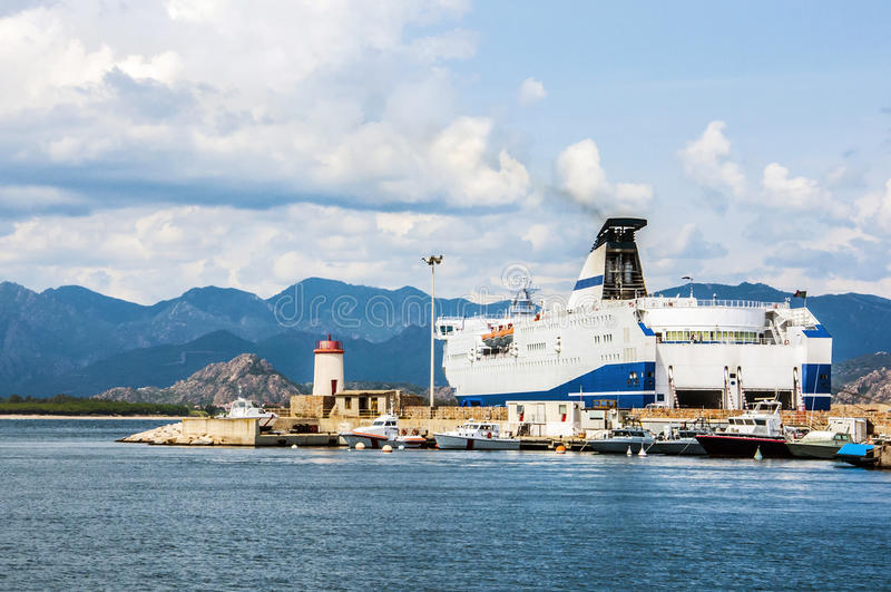 Coastline mountain view ferry port big harbor on sardegna island in italy stock image