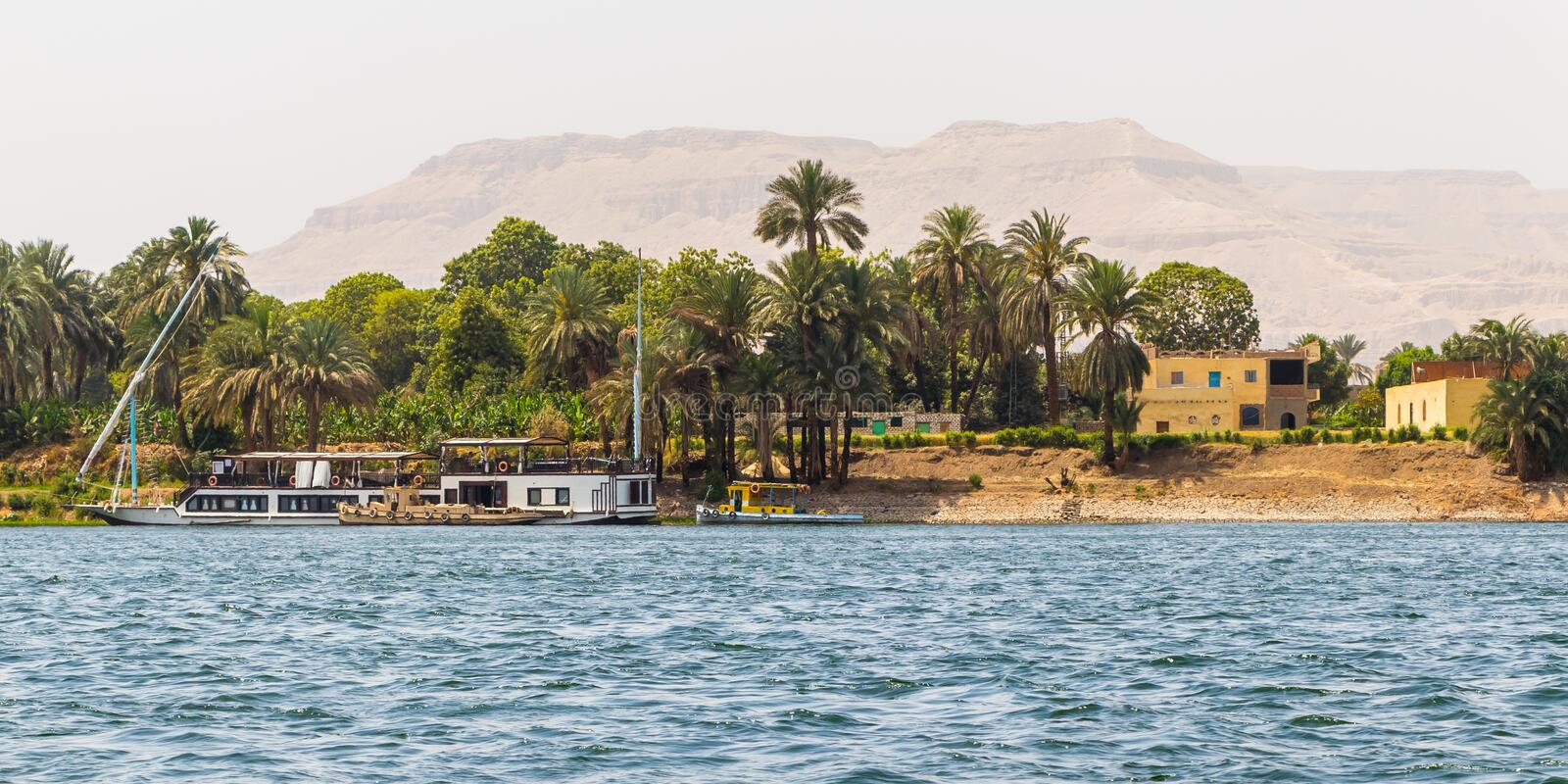 The coastline of the river Nile in Luxor, Egypt. Nile River is the longest river in the world, called the father of African rivers. It rises south of the Equator stock image