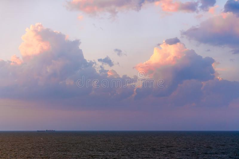 Coastline of the sea in the rays of the setting sun stock images