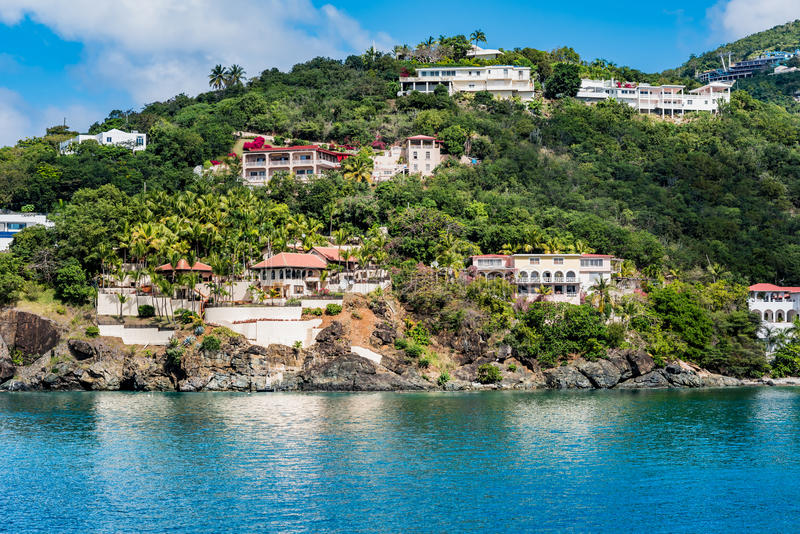 Coastline of St. Thomas with Vacation Homes on the Hillside. Reflecting into the blue Caribbean sea royalty free stock image