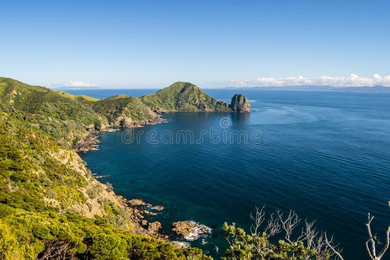 Coastline view from Coromandel Coastal Walkway with blue sky above at Coromandel Peninsula, Northland, New Zealand royalty free stock image