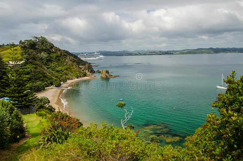 Coastline view from Tapeka Point Track with blue sky above in Russell, Northland, New Zealand.  stock photo