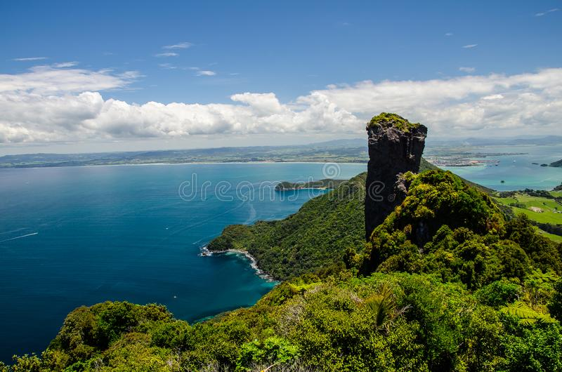 Coastline view from the top of Te Whara Track with blue sky above in Whangarei Heads, Northland, New Zealand.  royalty free stock image