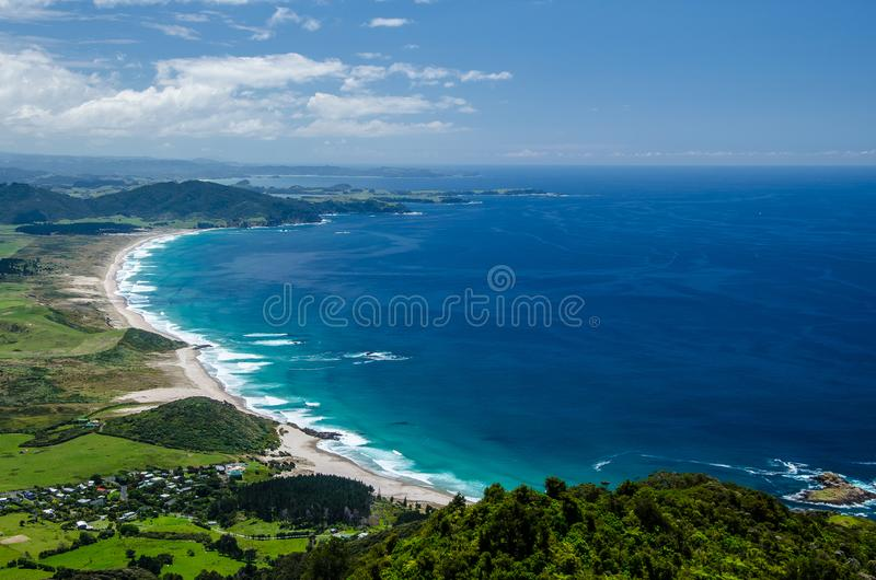 Coastline view from the top of Te Whara Track with blue sky above in Whangarei Heads, Northland, New Zealand.  royalty free stock photography