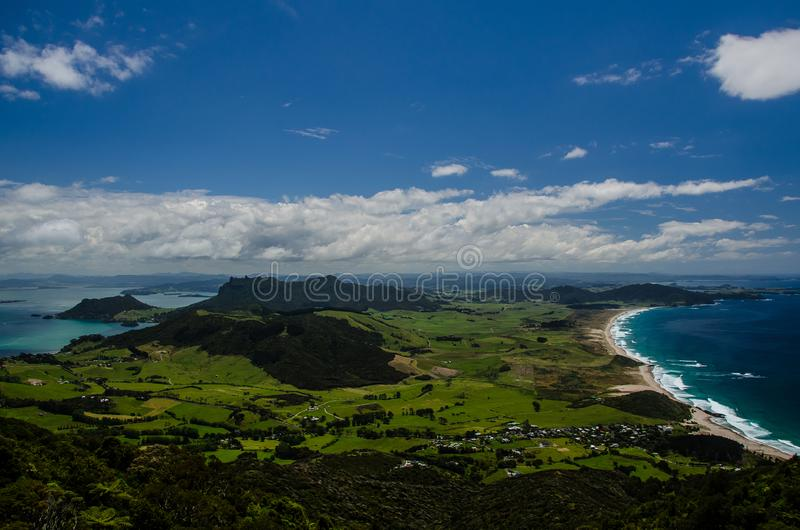 Coastline view from the top of Te Whara Track with blue sky above in Whangarei Heads, Northland, New Zealand.  stock images