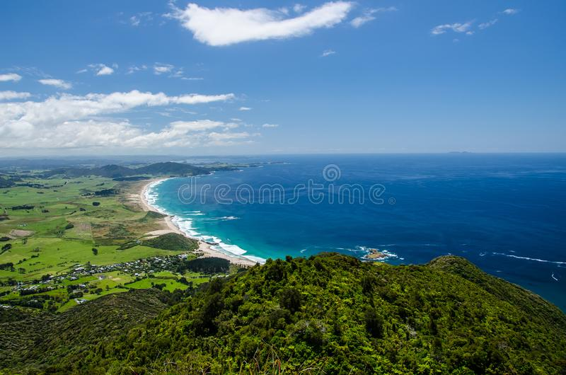 Coastline view from the top of Te Whara Track with blue sky above in Whangarei Heads, Northland, New Zealand.  royalty free stock photo