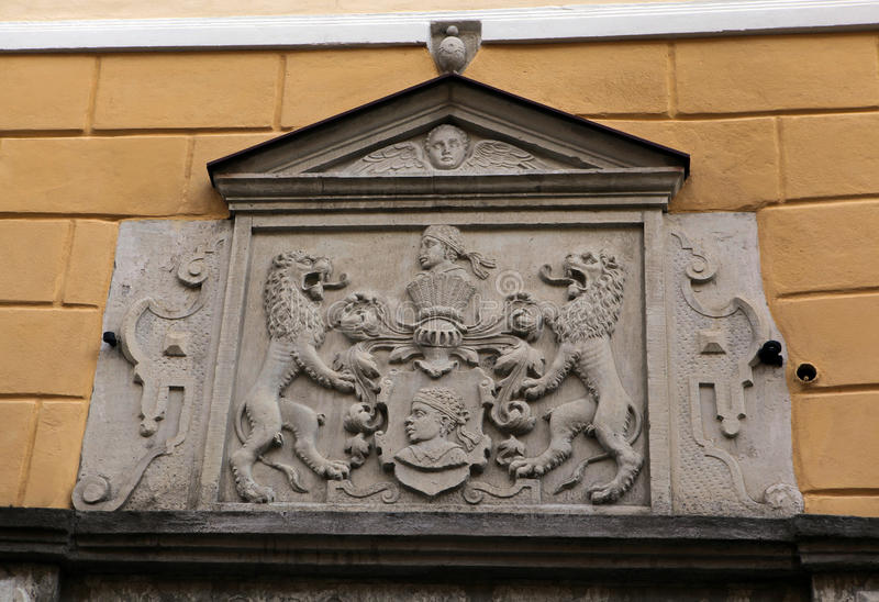 Coat of arm.Tallinn. Estonia. Coat of arms of House of the Brotherhood of Blackheads (16th century). Detail of the door. Pikk Street. Tallinn. Estonia royalty free stock image