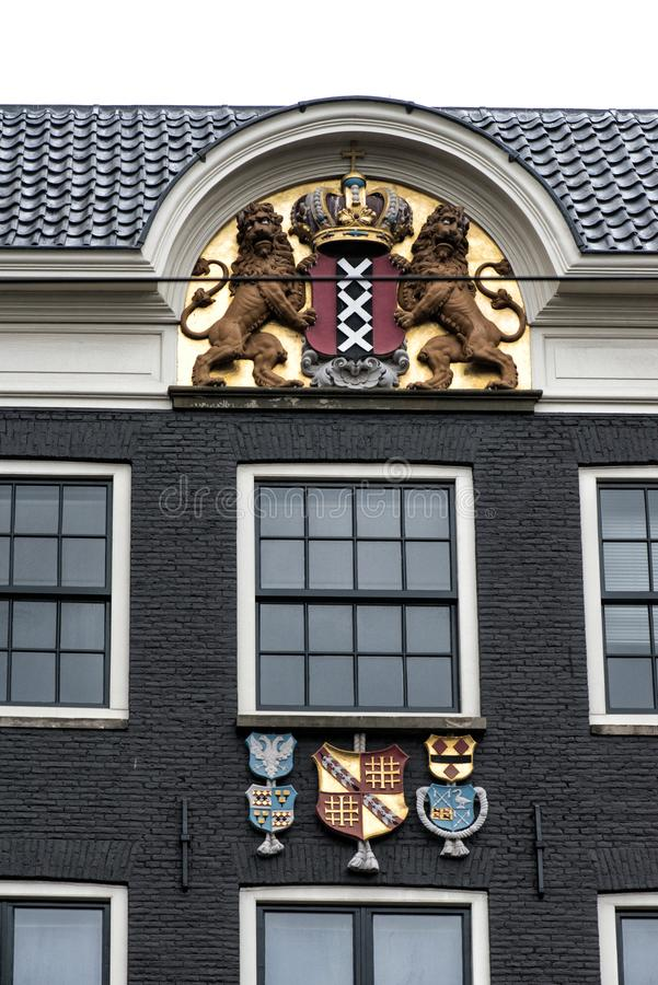 Coat of arms of Amsterdam on the facade of the house in Amsterdam, Netherlands stock photography