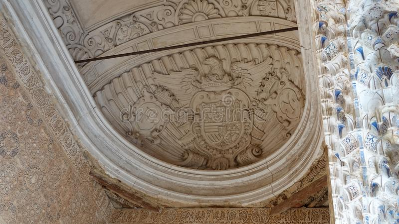 Coat of arms of the Catholic monarchs at Nasrid palace of the Alhambra in Granada, Andalusia. Coat of arms ceiling of king Ferdinand and queen Isabella at the stock photos