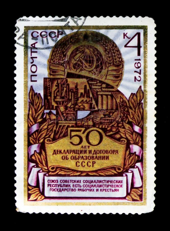 Coat of arms and industries scenes, 50th anniversary of USSR, circa 1972. MOSCOW, RUSSIA - JUNE 26, 2017: A stamp printed in USSR Russia shows Coat of arms and royalty free stock photos