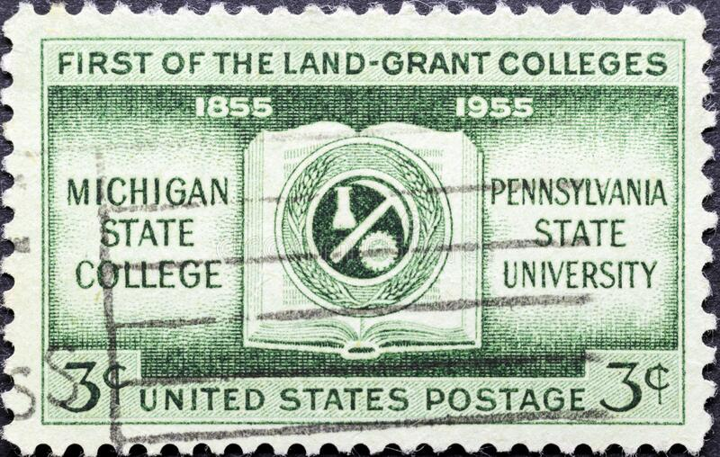 Coat of arms of Michigan State College, Pennsylvania University, First of the Land-Grant Golleges. MADRID, SPAIN - MARCH 13, 2020. Vintage stamp printed in royalty free stock photos