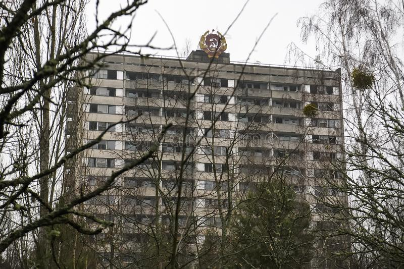 Coat of arms of Soviet Union on building in abandoned Prypiat, near Chernobyl nuclear power plant. December 2019. Coat of arms of Soviet Union on building in stock image