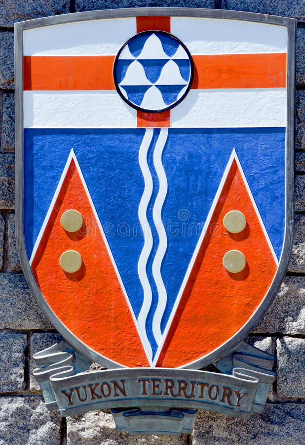 Coat of arms of Yukon Territory. VICTORIA BC CANADA JUNE 22 2015: Coat of arms of Yukon Territory. Yukon the westernmost and smallest of Canada's three federal stock image