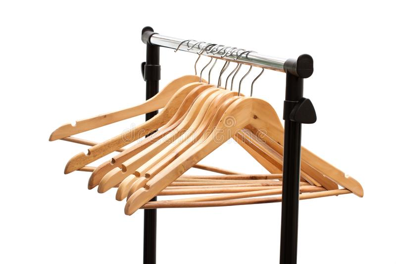 Coat hangers on a clothes rack royalty free stock image