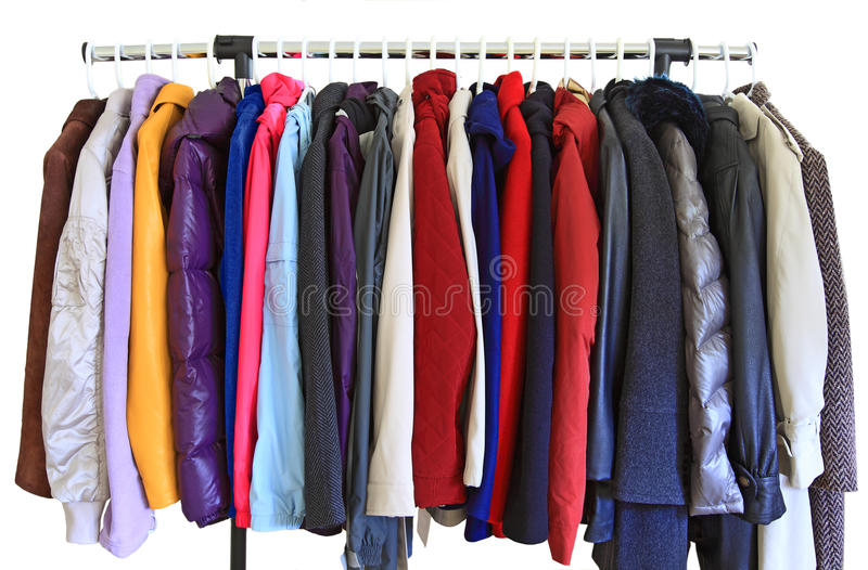 Coat and Jackets. Women coat and jacket on hangers isolated over white background stock photo