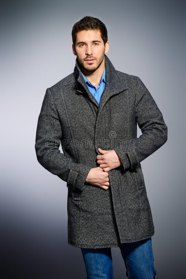 Coat and jeans royalty free stock photography