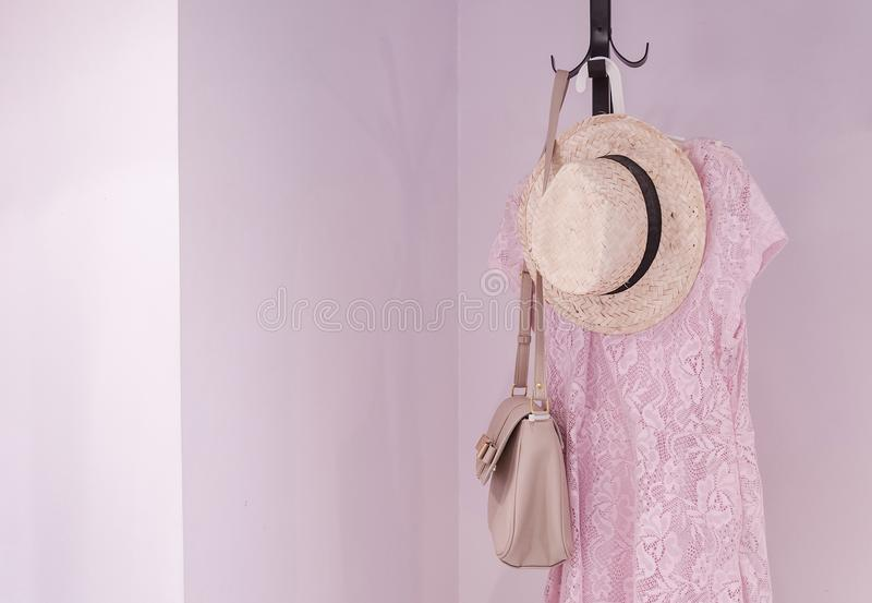 Coat rack with female accessories in bedroom, interior design for home stock photos