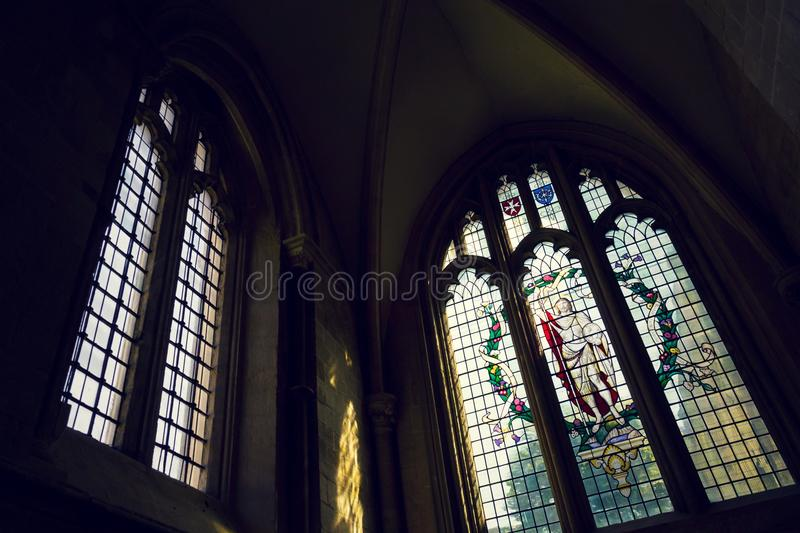Coats of arms on stained glass window in Chichester Cathedral stock image