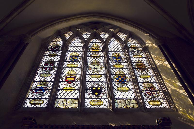 Coats of arms on stained glass window in Chichester Cathedral royalty free stock photo