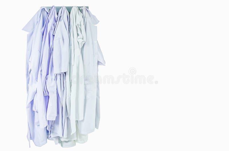 Coats. Hanging on white background isolate royalty free stock image