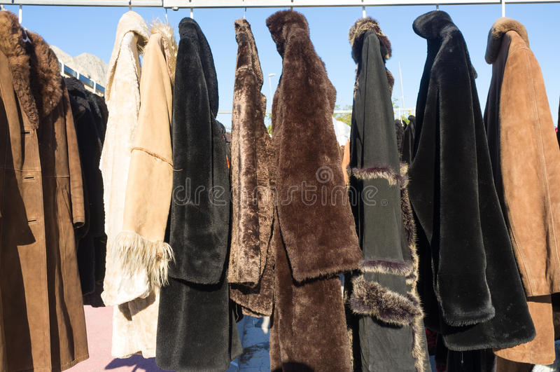 Coats. Second hand coats for sale on a street market stall royalty free stock photos