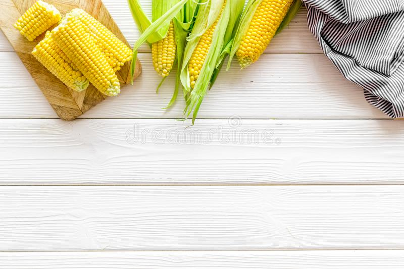 Cob corns on white wooden background top view mockup royalty free stock photo