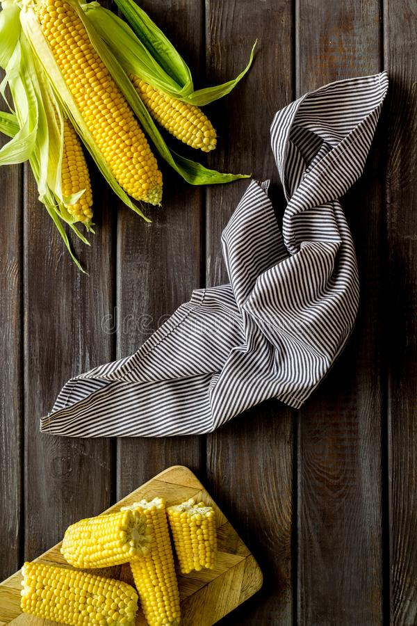Cob corns on wooden background top view stock images