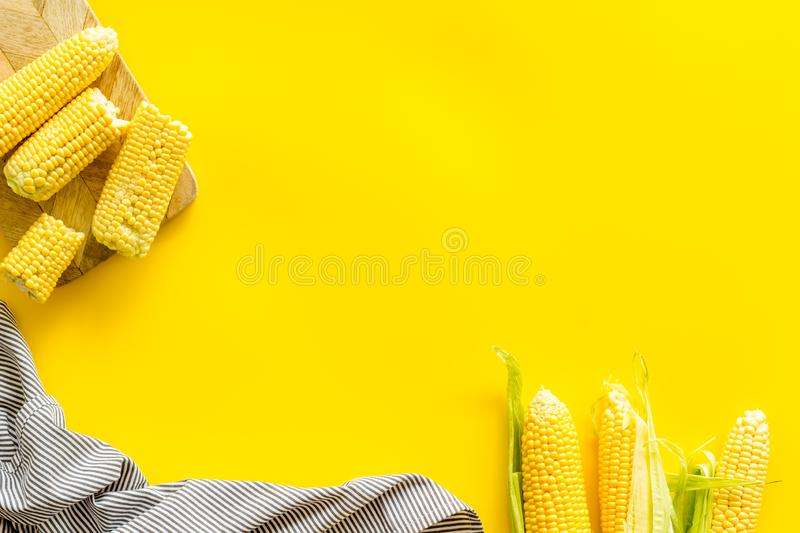 Cob corns on yellow background top view mockup royalty free stock photo