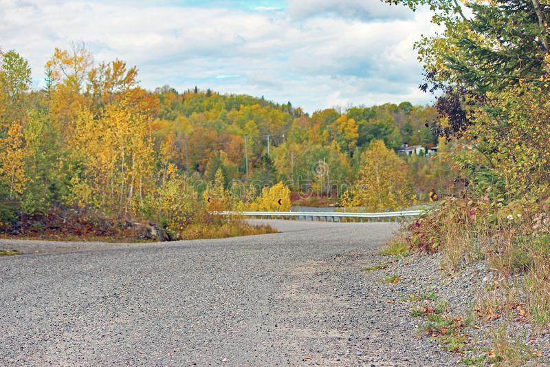 Cobalt, Ontario Gravel Road. Curving road with fall colours near Cobalt, Ontario in northeastern Ontario, Canada stock photo