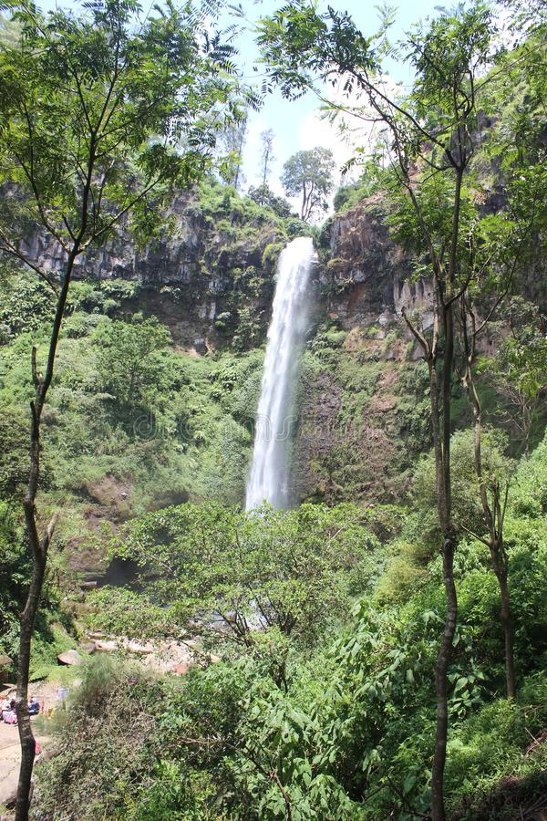 Coban Rondo, Wonderful Waterfall. Coban Rondo waterfall is a beautiful water fall on the slope of Mount Panderman resort that is about 32 km to the west from royalty free stock photos