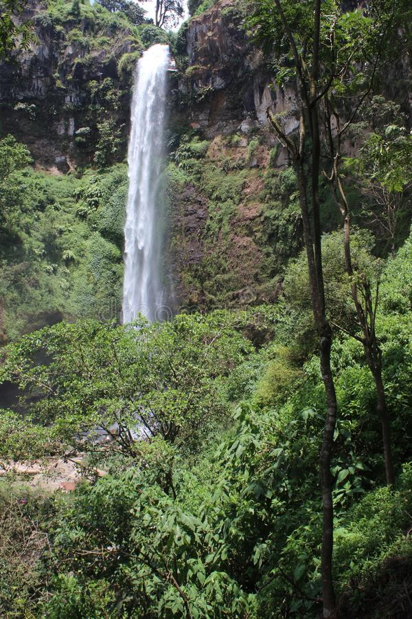 Coban Rondo, Wonderful Waterfall. Coban Rondo waterfall is a beautiful water fall on the slope of Mount Panderman resort that is about 32 km to the west from royalty free stock image