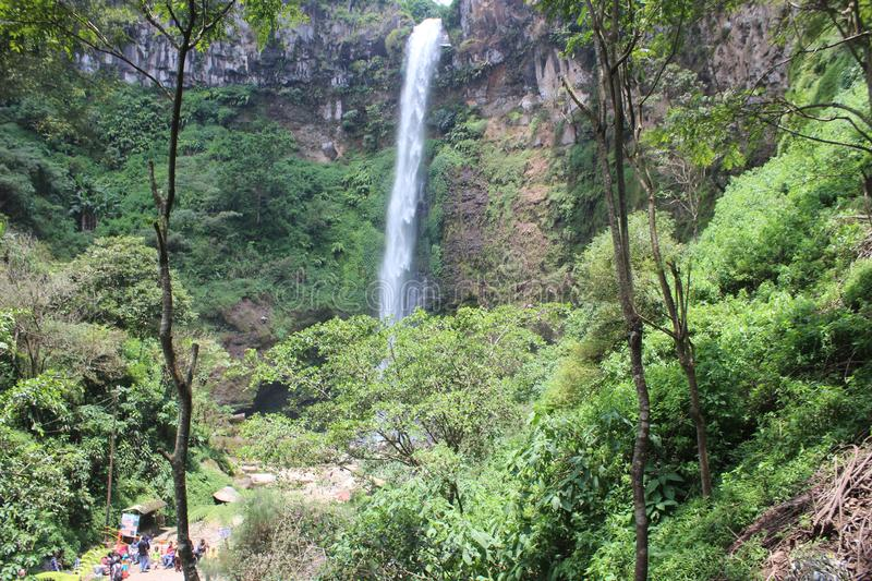 Coban Rondo, Wonderful Waterfall. Coban Rondo waterfall is a beautiful water fall on the slope of Mount Panderman resort that is about 32 km to the west from stock photography